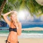 Woman on a tropical beach — Stock Photo #76040489