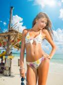 Young girl at the beach bar — Stock Photo