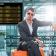 Man in suit waiting at the international airport — Stock Photo #78029924