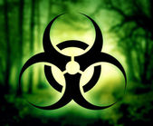 Biohazard symbol with glowing forest — Stock Photo