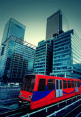London, Canary Wharf with train — Stock Photo