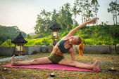 Young woman yoga stretching — Stock Photo