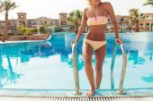 Young woman in pool — Stock Photo