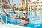 Girl in pool — Stock Photo