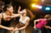 People dancing blur background — Stock Photo