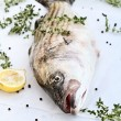 Striped Bass With Fresh Herbs and Lemons — Stock Photo #52467065