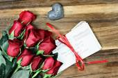 Dozen Roses with Old Letters — Stock Photo
