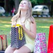 Young woman having fun in the park after shopping — Stock Photo #53810627