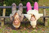 Two teenage girlfriends having fun in tha nature on beautiful au — Stock Photo