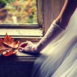 Detail of the brides hand holding autumn leaf while sitting in f — Stock Photo #57941171