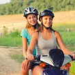 Two teenage girls riding motorcycle in the nature — Stock Photo #58814999