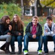 Four teenage friends having fun in the park — Stock Photo #59398965