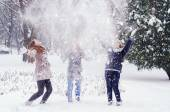 Three teenage girls throwing snow in the air on beautiful winter — Stok fotoğraf
