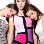 Three elegant beautiful girls posing isolated on white backgroun — Stock Photo #67317215