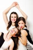 Three beautiful fashionable girls having fun isolated on white b — Photo