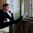 Beautiful fitness girl stretching in abandoned building before workout — Stock Photo #74263469