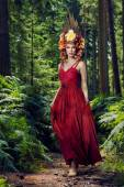 Beautiful woman in forest — Stock Photo