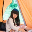 The little girl in a tent — Stock Photo #57797637