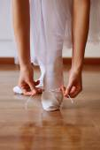 Featured dance shoes and hands — Stock Photo