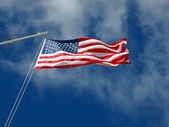 The American Flag Hanging Before Wispy Clouds — Foto Stock