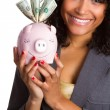 Black Woman Holding Piggy Bank — Stock Photo #82175528