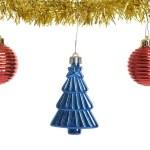 Three christmas ornaments on gold garland — 图库照片 #58660985