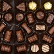 Box of chocolates background — Stock fotografie #62614413