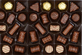 Box of chocolates background — Stock Photo