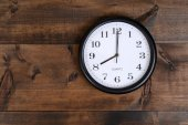 Clock on old wood — Stock Photo