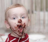 Chocolate on face — Stock Photo