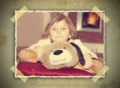 Vintage picture of girl with teddy bear — Stock Photo
