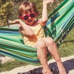 Little girl on a hammock — Stock Photo #66047659