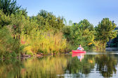 Woman is kayaking on small lake — ストック写真