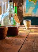 Bottle of wine on table — Stock Photo