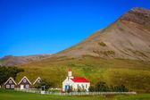 Church and turf houses — Stock Photo