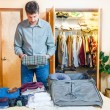 Man packing his suitcase — Stock Photo #57165627