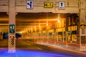 Underpass at night with light streaks — Stock Photo