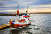 Small fishing boat at pier — Stock Photo