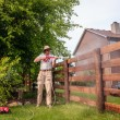 Man is cleaning wooden fence — Stock Photo #60347221