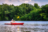 Woman is kayaking on lake — ストック写真