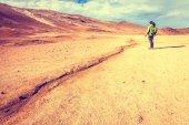 Hiker in geothermal field — Stock Photo