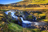 Waterfall in valley by Seydisfjordur fjord — Stock Photo