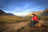 Woman is taking a rest from a hike — Stock Photo