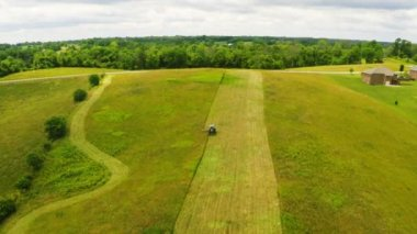 Tractor mowing hay in a field — Stock Video