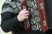 Man playing an accordion — Stock Photo
