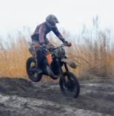 Off-road rider is jumping — Stock Photo