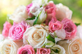 Beautiful wedding bouquet and rings — Stock Photo