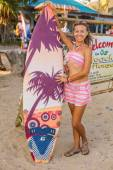 Girl with a surf board. — Stock Photo