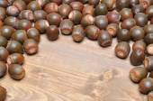 Brown acorns on board — Stock Photo