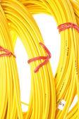 Yellow fiber optic cables — Stock Photo